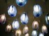 Lighting inside the store - a river of shades of blue lamps running down the middle length of the store